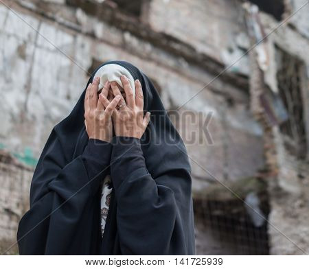 Desperate Syrian woman in destroyed city