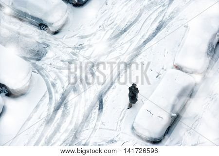 elevated view of snow covered parking lot.
