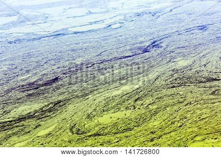 River With Damaged And Polluted Striped Yellow Water