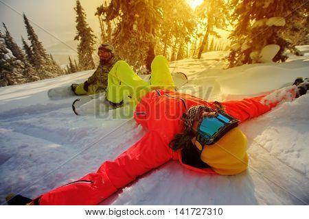 Young girls snowboarders enjoy in winter resort