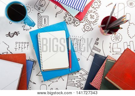 Office table with notepad and coffee cup. Business creative consept.