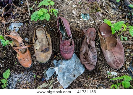 Old Shoes In The Dumpster