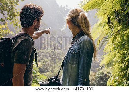 Young Couple Together Looking Into The Forest