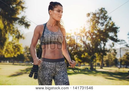 Focused Young Woman With Jump Rope At The Park