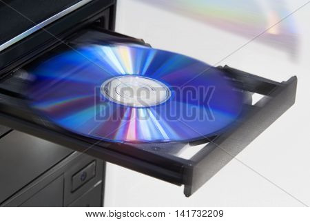 Ejecting disc from desktop computer with motion blur