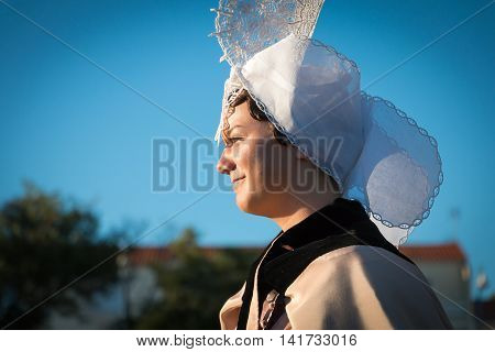 Woman Dressed In Traditional Clothes