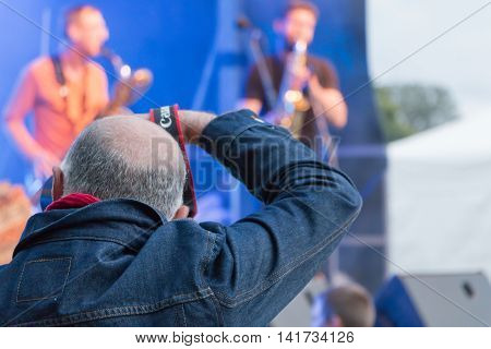 Photographer During A Free Concert