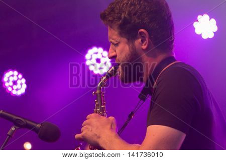 Saxophonist During A Free Concert