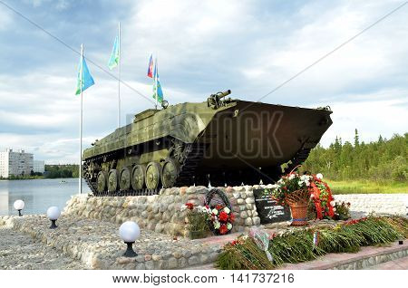 MONCHEGORSK, RUSSIA - AUGUST 2016: Infantry fighting vehicle, hoisted on pedestal on shore of Lake Komsomol - townspeople monument - combatants, local wars and armed conflicts