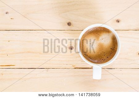 Coffee Cup On Wooden Floor