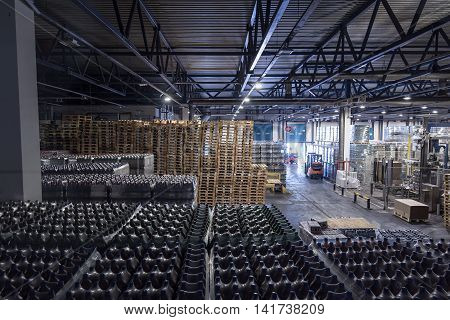Big stock at brewery with bottles of beer