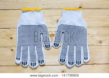 Gloves with blue anti slip on wooden background