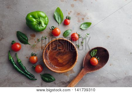 Wooden bowl with selection of fresh ingredients.