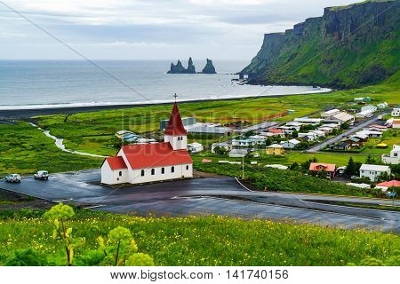View of church at the village of Vik in southern Iceland