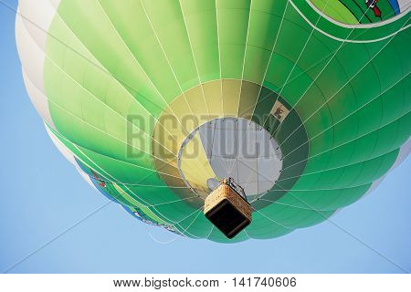 VILNIUS, LITHUANIA - AUGUST 21, 2015: Unidentified people fly in hot air balloon over the old town in Vilnius, Lithuania.