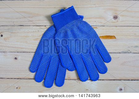 Blue Gloves On Wooden Table