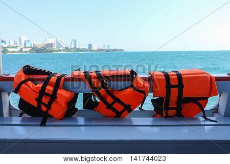 Safety life vests hanging on ferry boat