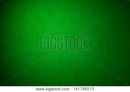 Old dark weathered grungy green wall background