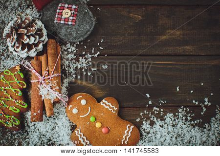 Wooden Background With Gingerbread Man, Cones, Snow, Top View, Close-up
