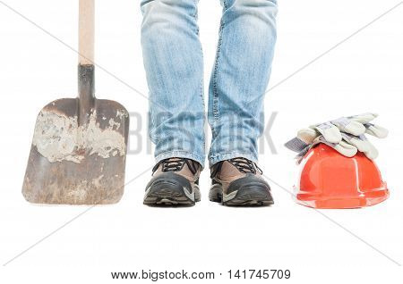 Worker Standing Near Shovel And Protection Gloves