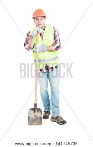 Thoughtful Builder Resting And Holding Shovel