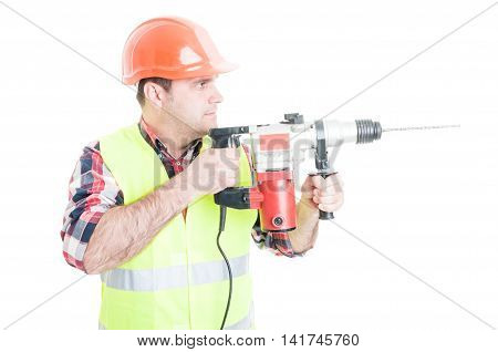 Workman With Helmet Holding The Drilling Machine