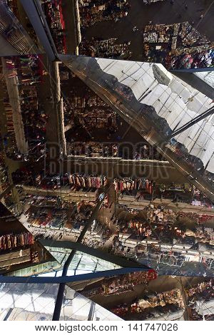 Barcelona Spain - April 4 2016: Inside of Mercat dels Encants reflection from the building's roof. It is a Barcelona's largest and best known flea market. One of the oldest flea markets in Europe and Spain.