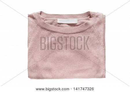 Elegant pink pullover folded on white background