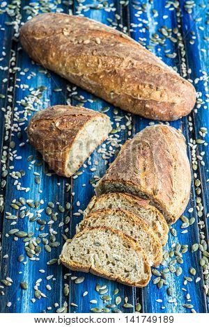 Spelt seed sourdough bread on a blue tableboard