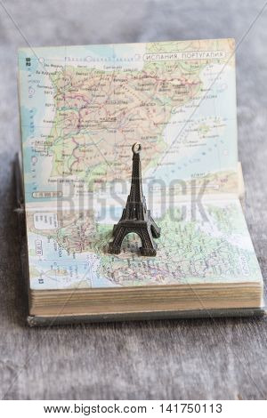 travel, journey, trip idea or vacation - map and the Eiffel Tower