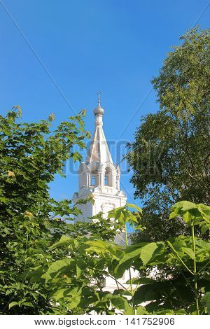 Watch tower of Spaso-Prilutsky Monastery in the Vologda city, Russia. Bell tower of the church among green trees