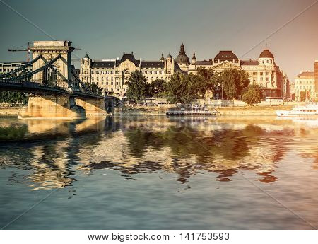 view on the chain bridge on the Danube river with reflection