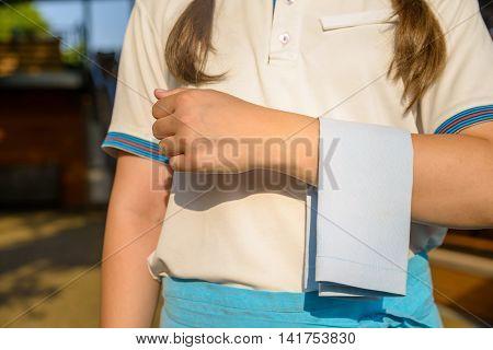 Cropped image of waitress carrying white napkin