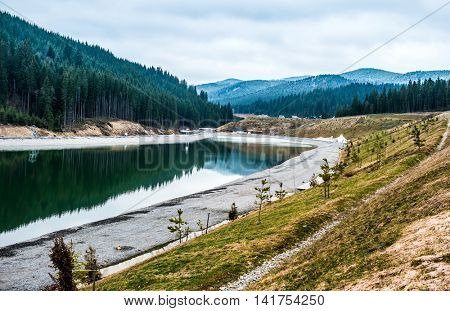 lake and new relaxation building in Bukovel resort in Ukrainian Carpathian Mountains