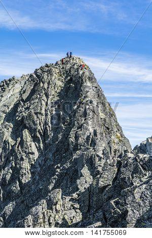 High Tatras Slovakia - June 23 2016: Teams of mountaineers on the ridge leading to the prominent peak in the Tatras.