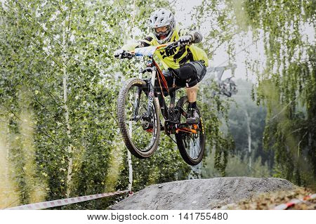 Magnitogorsk Russia - July 23 2016: young rider athlete on bicycle jump over obstacles during National championship downhill