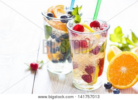 Fresh summer fruit detox iced water with berries and citrus.