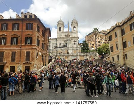 ROME, ITALY, MAY 30, 2013: a view of the Spanish Steps, people, and the Trinita dei Monti Church in the afternoon, on a cloudy day