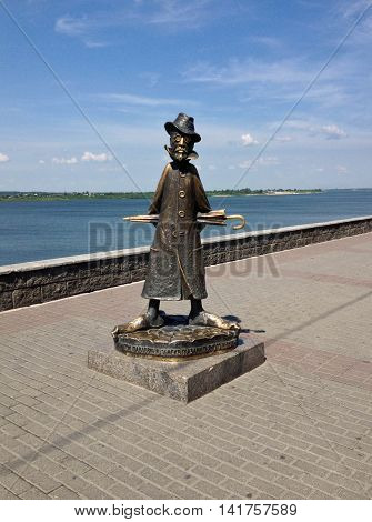TOMSK, SIBERIA, RUSSIA, JULY 4, 2014- view of Anton Chekhov Monument, on a brick walkway, with a river and blue sky in the backgound, mid-morning