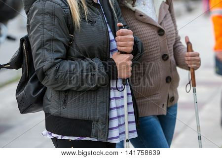 Close Up In Blind Woman's Hands Holding A Stick
