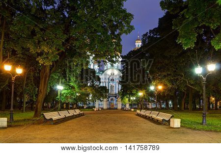 Night illuminated alley in Nikolsky garden and St. Nicholas Naval Cathedral St. Petersburg Russia