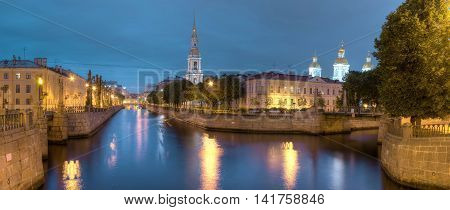 Night view on illuminated Kryukov Canal Griboedov Canal and St. Nicholas Naval Cathedral St. Petersburg Russia