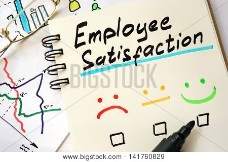 Sign employee satisfaction on a page of notebook.