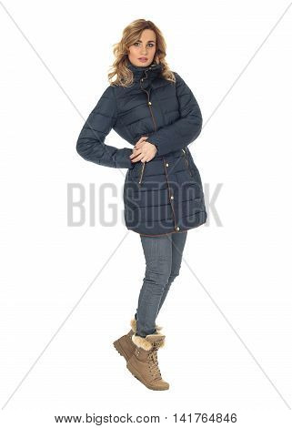 Beautiful woman in blue winter coat isolated