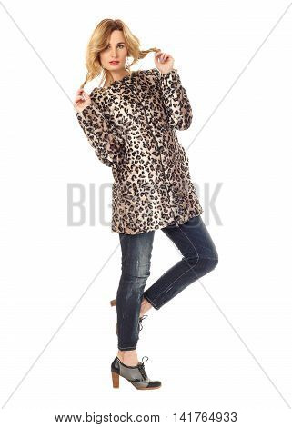Beautiful woman in leopard winter coat isolated