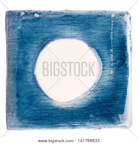 Blue handmade glazed ceramic tile with big white dot in middle isolated on white
