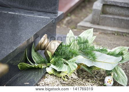 Close Up On Broken Flowers On The Gravestone