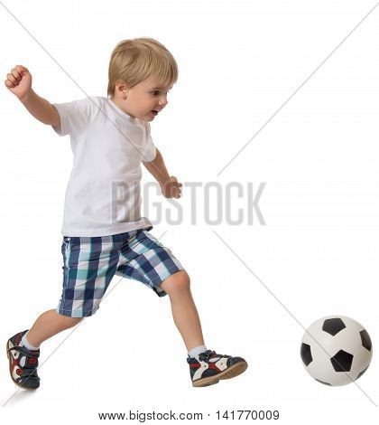 Little blond boy in a clean white t-shirt and shorts playing football - Isolated on white background