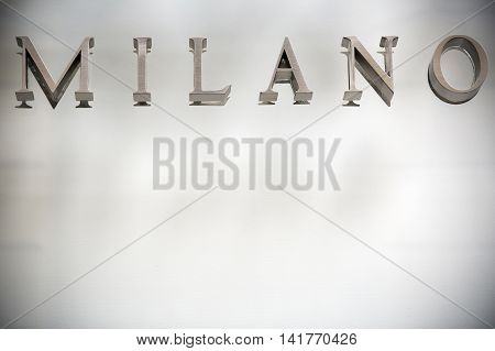 Municipal sign of the stylish Italian city Milan in elegant lettering with clear background area below