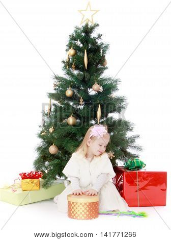 Happy little girl near a Christmas tree surrounded by gifts- Isolated on white background
